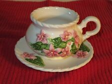 Pottery Cup and Saucer with Pink Flowers and Rope Style Edging.