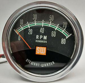 Vintage Stewart Warner 429370 green line 8,000 RPM hot rod tachometer with cup