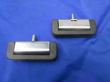 Two Black Hinge Rubbers With Metal Hinges For Industrial Machines.