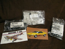 3 models in unopened plastic Mustang P-51B,Cessna, Ford Exp