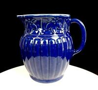 "STUDIO ART POTTERY BLUE STONEWARE HOLLY AND BERRIES RIBBED 7 1/2"" PITCHER"