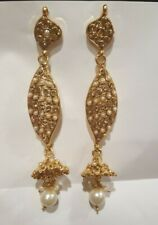 Golden earings with little white stones