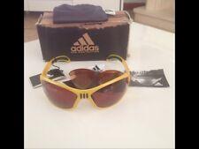 adidas occhiali sportivi nuovi con scatola, cartellini e lenti di Ricambio.