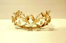 Gold colored metal tiara accented with pearls