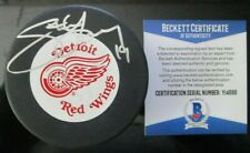 STEVE YZERMAN SIGNED DETROIT RED WINGS VINTAGE TRENCH PUCK BECKETT COA Y14696