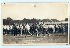 "1915 original photo postcard of fans at a football game; ""Football Rush"""