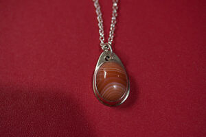 Sterling silver and banded agate pendant necklace,