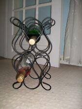 "Black metal   wine rack holds 6 bottles , 14.5""  tall"