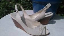 F&F LEATHER WEDGED PEEP TOE SANDALS WITH FREE WHITE PAIR THE SAME.