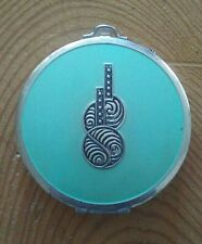Art Deco Evans mesh bottom compact with mirror and powder puff.