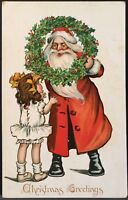 Girl Reaches Up To Santa Claus Holding Large Wreath ~ Tuck Kris Kringle Series