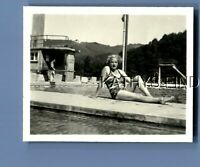 FOUND B&W PHOTO N+0624 PRETTY WOMAN IN SWIMSUIT POSED SITTING BY WATER