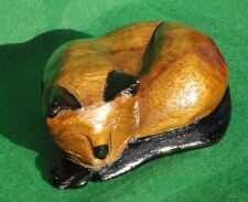 LARGE CARVING OF A SLEEPING CAT WITH BLACK EARS IN DARK OAK STAINED WOOD