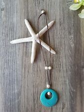 Australian Kangaroo Leather Necklace featuring a Turquoise Howlite Donut Pendant