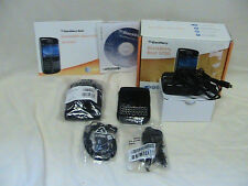 1 USED BLACKBERRY BOLD 9700 WITH CHARGER, SWIVEL HOLSTER, OTTERBOX, HEADPHONES