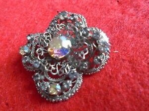 Lovely Open Work Flower Brooch With White Stones In Silver Coloured Metal
