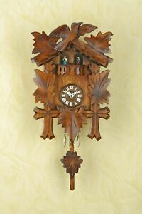 German Black Forest cuckoo clock with Quartz movement rotating dancers natural