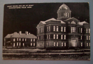 Court house and jail at night International Falls Minnesota, MN postcard