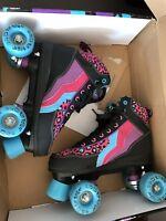 Rio roller quad skates size 4 Mint Condition Leopard print design.