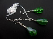 A GREEN CRYSTAL TEARDROP  NECKLACE AND EARRING SET  WITH 925 SILVER HOOKS.