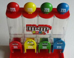 M&M M&M 's Spender mit 4 bunten Röhrchen in rot gelb grün blau