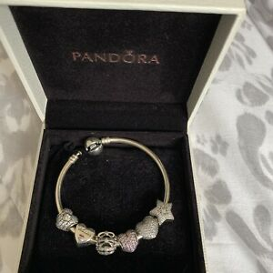 pandora Moments Bangle with charms used. Size 15 Which Is 13-14cm Wrist Diam