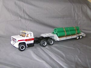1/34 First Gear GMC 6500 Series Tractor/Trailer with Pipe Load - Custom Built