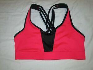 Champion sports bra-NWOT-size XS- black/orange-lined netting back and front