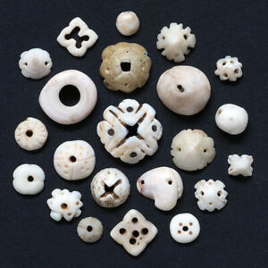 22 Antique carved conus shell hair adornment/trade beads. Mauritania. Tribal