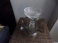 Lovely vintage style 2 tier glass candy dish about 9 inches tall.