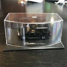 Collectible Anson scale model black Cadillac Escalade in clear display case.