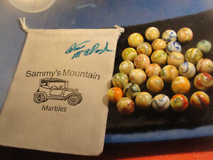 Sammy's Mountain Marbles in a bag signed by the Marble Master Dave McCullough