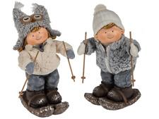 Dekoration Winterkinder, stehend 2erSet auf Ski Wolljacke u. Mütze bis 42 cm h