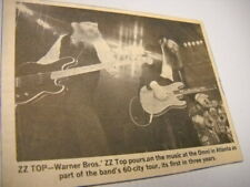 Zz Top on stage at the Omni in Atlanta 1980 music biz promo pic with text