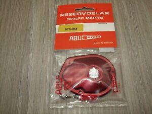 ABU AMBASSADEUR 1000 / 2000 RED LEFT SIDE PLATE UNUSED IN PACKAGING