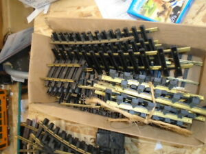 25 BOX OF BRASS TRACK