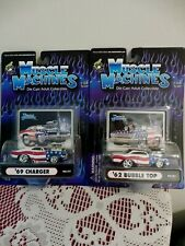 LOT OF 2 MUSCLE MACHINES 1:64 SCALE NEW IN PKGS ('69 CHARGER 7 '62 BUBBLE TOP)