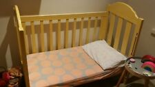 yellow wooden cot