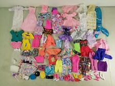 LARGE LOT OF BARBIE CLOTHES: GOWNS, DRESSES, SKIRTS, BLOUSES, SHOES, etc.