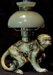 Miniature Lamp (oil) Monkey, Porcelain, German, Gray cased glass shade, working