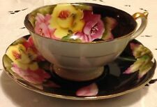 Taiyo teacup and saucer - black with bold pink & yellow roses