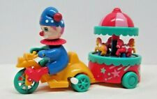 Vintage Plastic Wind Up Clown Riding Bike pulling Merry Go Round