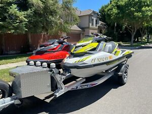 Two 2018 SeaDoo RXP jetski with trailer and covers