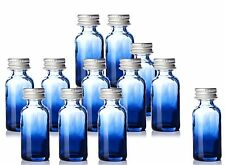 1oz Boston Round Glass Shaded Blue Bottles. With Silver Aluminum Lids 12 pcs NEW