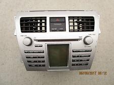 06 - 09 TOYOTA YARIS S CD MP3 WMA CD PLAYER RADIO AIR VENT BEZEL P/N 86120-52690