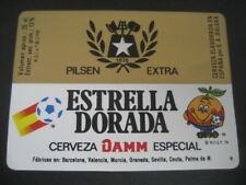 ETIQUETA CERVEZA ESTRELLA DORADA DAMM. MUNDIAL FUTBOL ESPAÑA 1982. NARANJITO