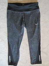 NIKE DRI FIT ANIMAL PRINT STRETCH FITTED CAPRIS WORKOUT PANTS ATHLETIC SMALL NWT