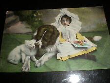 Old postcard child with two dogs c1900s