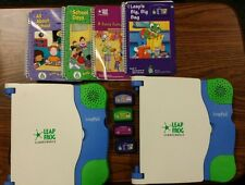 2 LeapPad LeapFrog Schoolhouse Systems with 4 Books & Cartridges. Model E18000