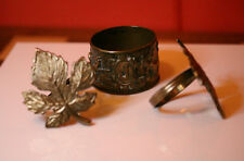 An interesting antique Napkin. Engraved Brass. Plus Two Leaf Napkin Rings